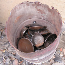 chamba pots  in metal drums read for glaze