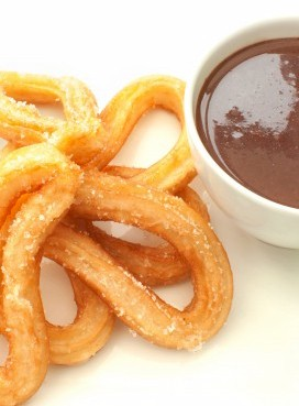 fresh churros with chocolate