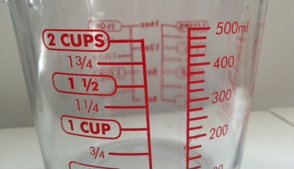 measuring cup showing cups and ml increments