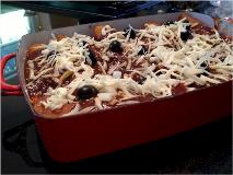 unbaked enchiladas in pan