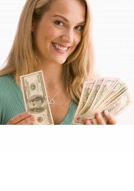 thin woman holding dollars