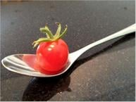 cherry tomato in spoon