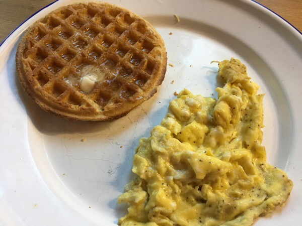 waffle and scrambled egg on plate
