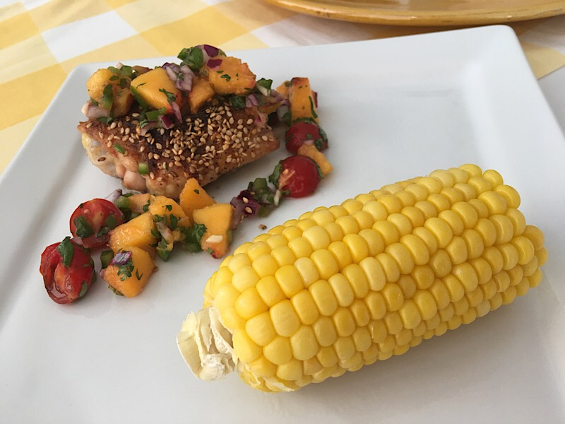 chicken with peach salsa with corn on cob