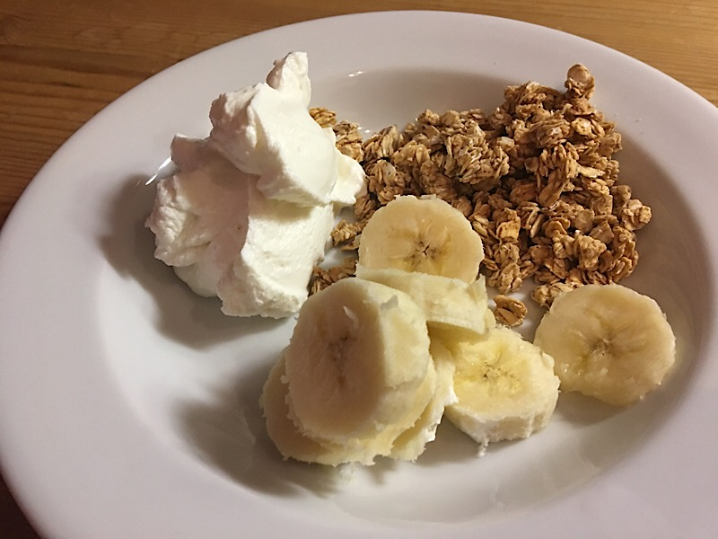 granola yogurt and banana breakfast