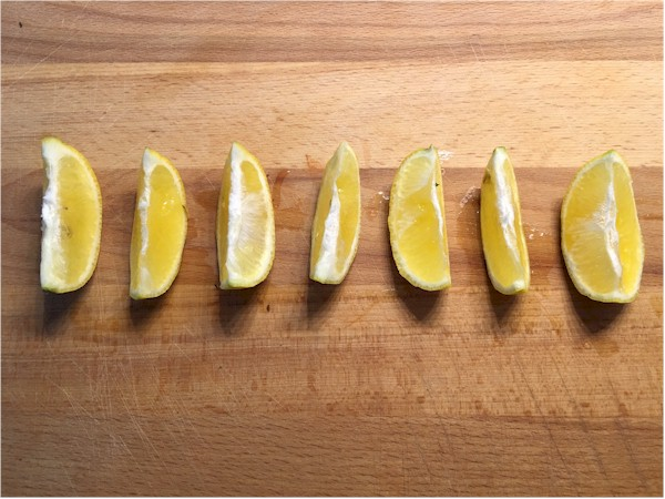 lemon wedges on cutting board