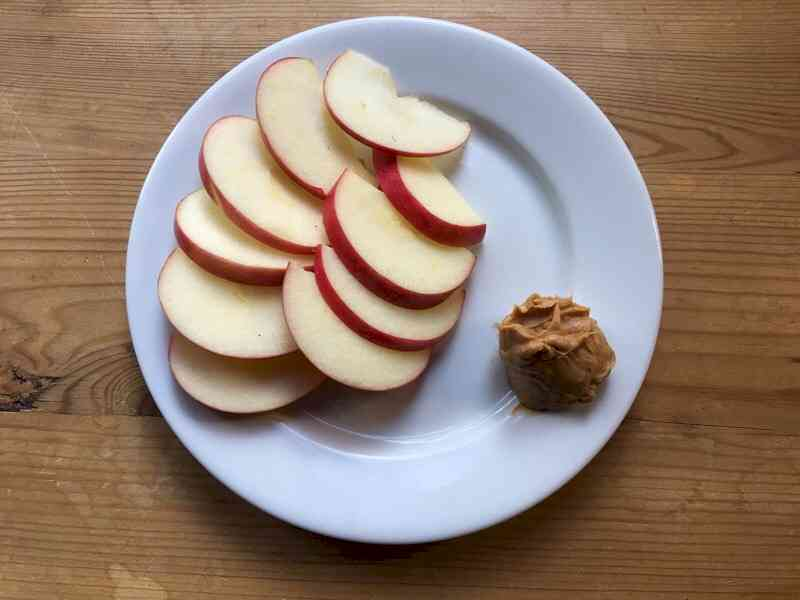 honey crisp apple with peanut butter on plate