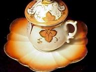 apricot orange and gold pot de creme cup with flower shaped saucer