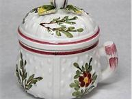 mottahedeh ermine tail pot de creme cup with flowers and leaves and red trim