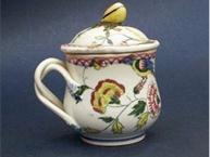 faience floral pot de creme cup with twisted branch handle