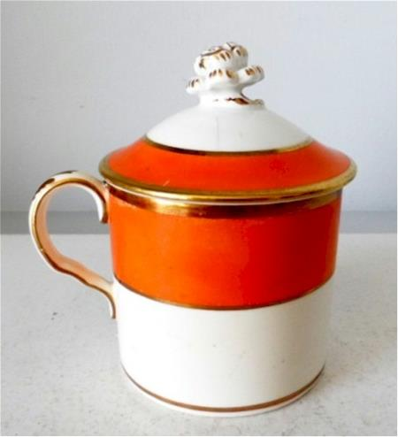 can shaped orange and white pot de creme cup gold trim side view