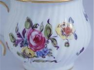 hochst floral on white pot de creme cup close up flowers