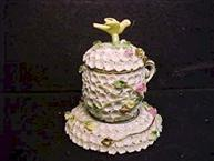 miesen pot de creme cup with applied white flours and bird finial