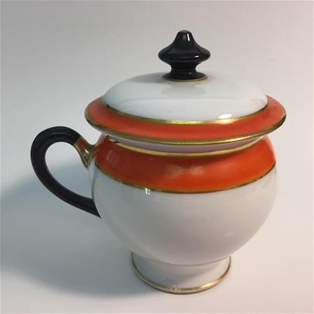 orange pot de creme black handle left view