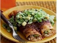 chicken and avocado enchiladas on plate