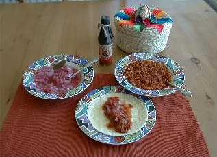 cochinita pibli with condiments