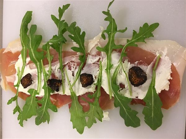 prosciutto-arugula-fig-wraps with arugula layerd on top