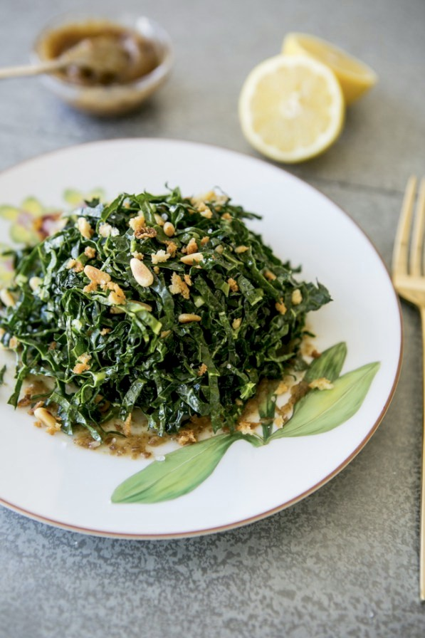 shredded kale salad with date puree and pine nuts