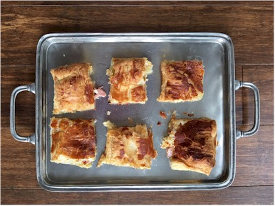 gruyere and ham puffs on tray