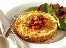 Image of Pecan Crusted Crab Tartlet With Boursin Cheese, Caramelized Onions, Roasted Garlic And Tomatoes, Gourmet Sleuth