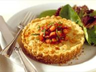 Pecan Crusted Crab Tartlet with Boursin Cheese, Caramelized Onions, Roasted Garlic and Tomatoes