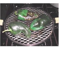 poblano chiles on a stove top grill